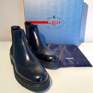 Prada Spazzolato Wing Tip Chelsea Boots